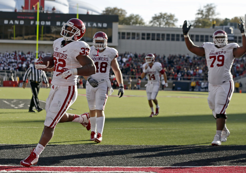 Photo - Oklahoma's Samaje Perine (32) scores a touchdown during a college football game between the University of Oklahoma Sooners (OU) and the Texas Tech Red Raiders at Jones AT&T Stadium in Lubbock, Texas, Saturday, November 15, 2014.  Photo by Bryan Terry, The Oklahoman