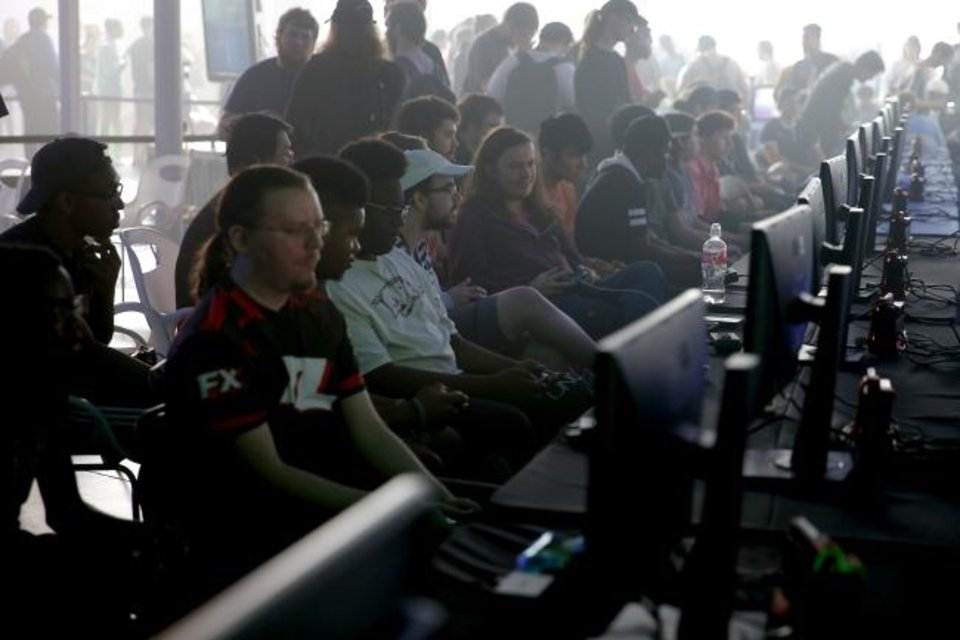 Photo -  Players compete Saturday in a Super Smash Brothers community tournament in Oklahoma City University's River Rumble at the Devon Boathouse. [Bryan Terry/The Oklahoman]