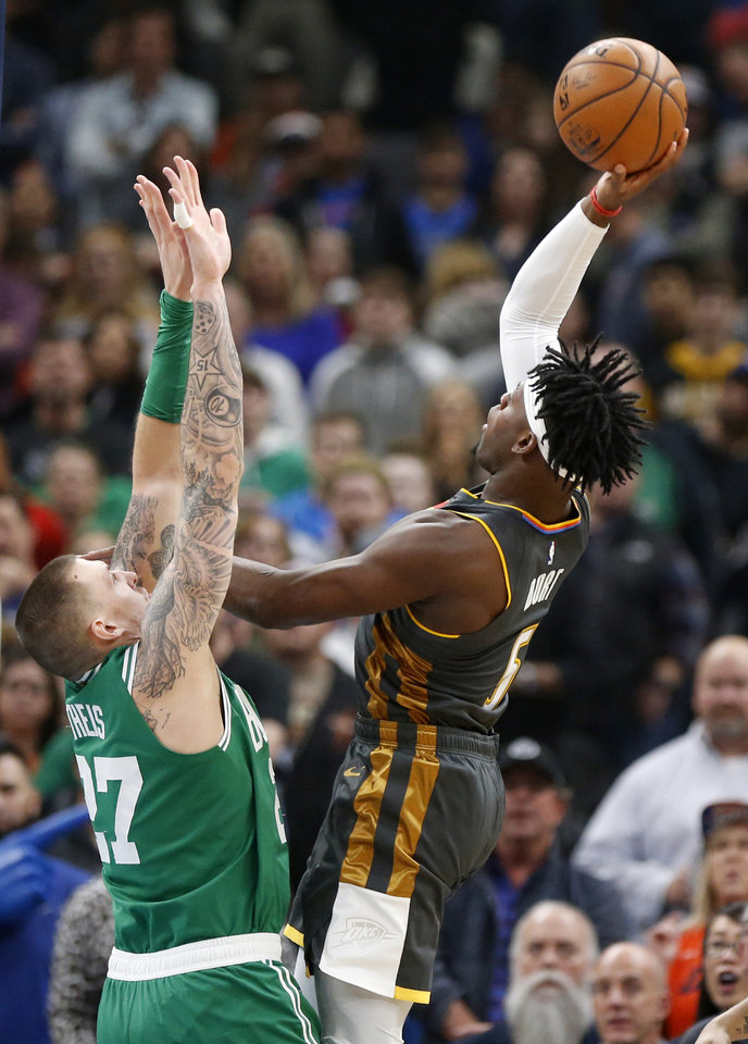 Photo - Oklahoma City's Luguentz Dort (5) shoots over Boston's Daniel Theis (27) in the first quarter during an NBA basketball game between the Oklahoma City Thunder and the Boston Celtics at Chesapeake Energy Arena in Oklahoma City, Sunday, Feb. 9, 2020. [Nate Billings/The Oklahoman]