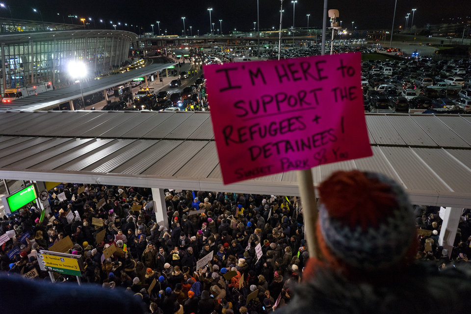 Photo - Protesters assemble at John F. Kennedy International Airport in New York, Saturday, Jan. 28, 2017 after earlier in the day two Iraqi refugees were detained while trying to enter the country. On Friday, Jan. 27, President Donald Trump signed an executive order suspending all immigration from countries with terrorism concerns for 90 days. Countries included in the ban are Iraq, Syria, Iran, Sudan, Libya, Somalia and Yemen, which are all Muslim-majority nations. (AP Photo/Craig Ruttle)