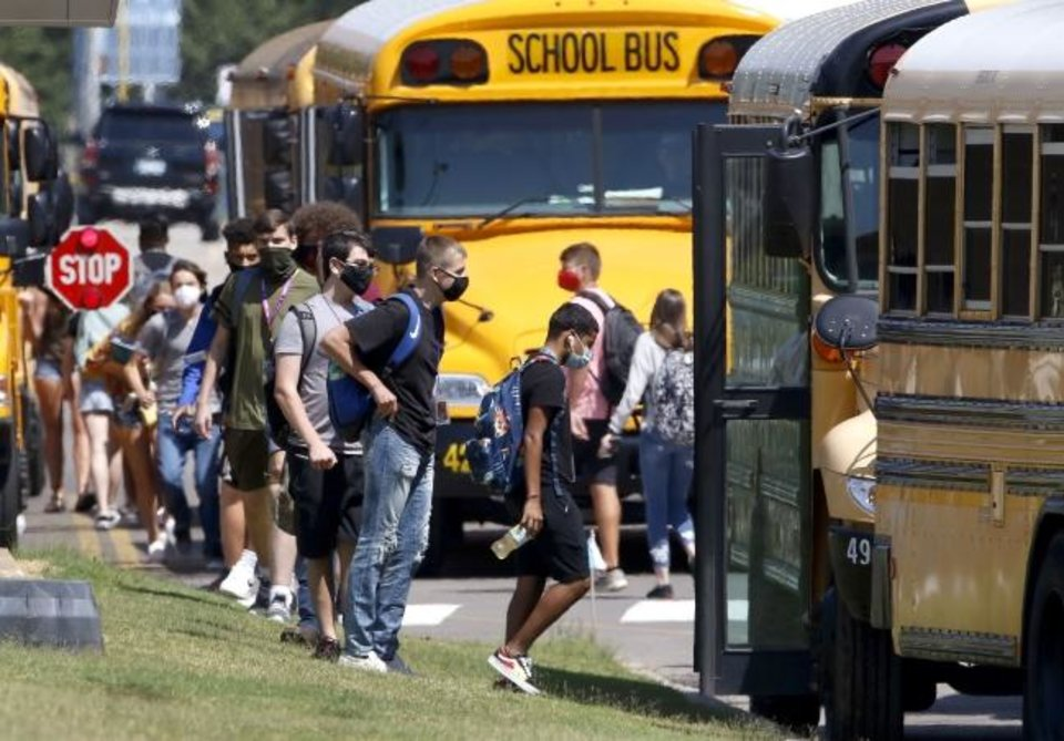 Photo -  Moore High School students leave school after the first day of classes in Moore on Thursday. [Bryan Terry/The Oklahoman]