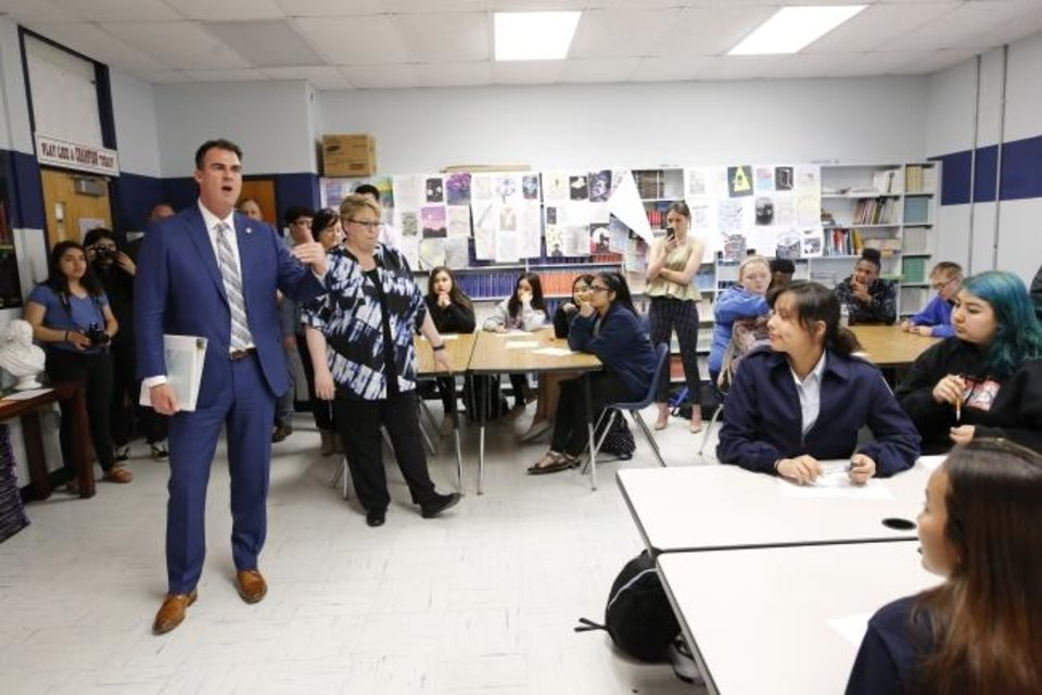 Photo -  Gov. Kevin Stitt answers a few questions from students after watching a presentation by  senior Brynna Tillman during a tour Wednesday of Southeast High School. [Jim Beckel/The Oklahoman]