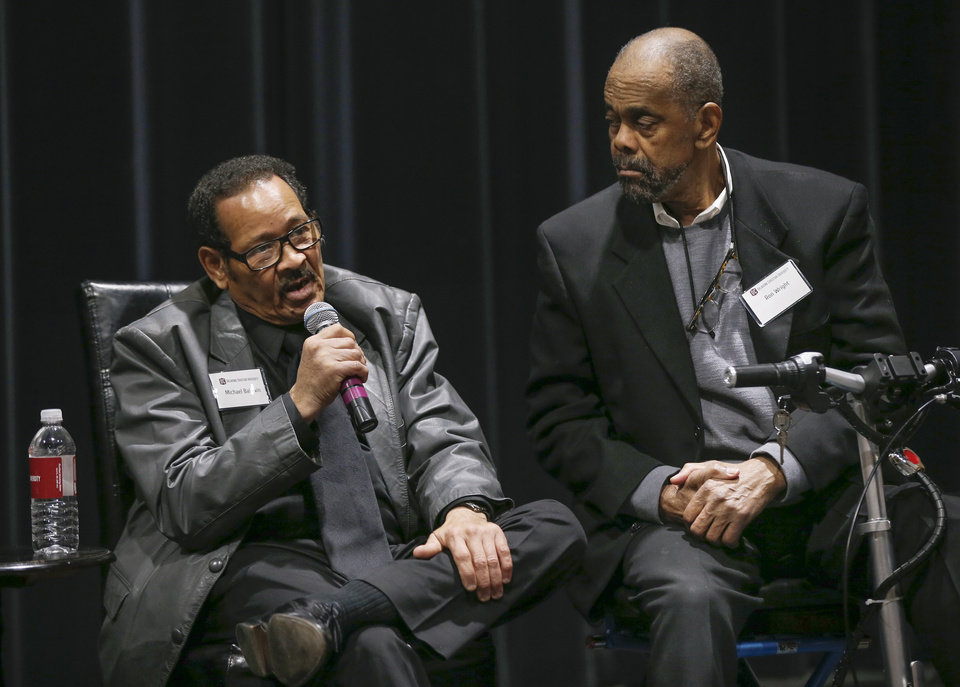 Photo - Michael Baldwin, left, speaks next to Ron Wright during a panel discussion of former students who were expelled from then Oklahoma Christian College and arrested in 1969 after the Benson Hall sit-in to protest the expulsion of black basketball players who were accused of attending an interracial gathering off campus, at Oklahoma Christian University's Judd Theatre in Oklahoma City, Wednesday, March 6, 2019. Baldwin and Wright are part of what OC calls Oklahoma Christian's 18. Photo by Nate Billings, The Oklahoman