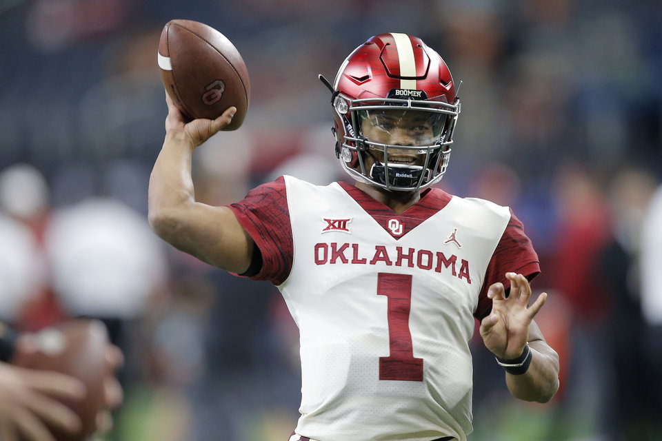 Photo - Oklahoma's Kyler Murray (1) warms up before the Big 12 Championship football game between the Oklahoma Sooners (OU) and the Texas Longhorns (UT) at AT&T Stadium in Arlington, Texas, Saturday, Dec. 1, 2018.  Photo by Bryan Terry, The Oklahoman