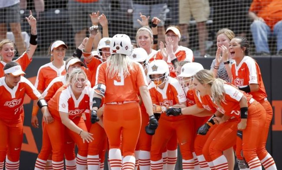 Photo -  Samantha Show heads home to a welcoming party of OSU teammates after her home run last Friday against Tulsa in the Stillwater Regional of the NCAA softball tournament. [Sarah Phipps/The Oklahoman]