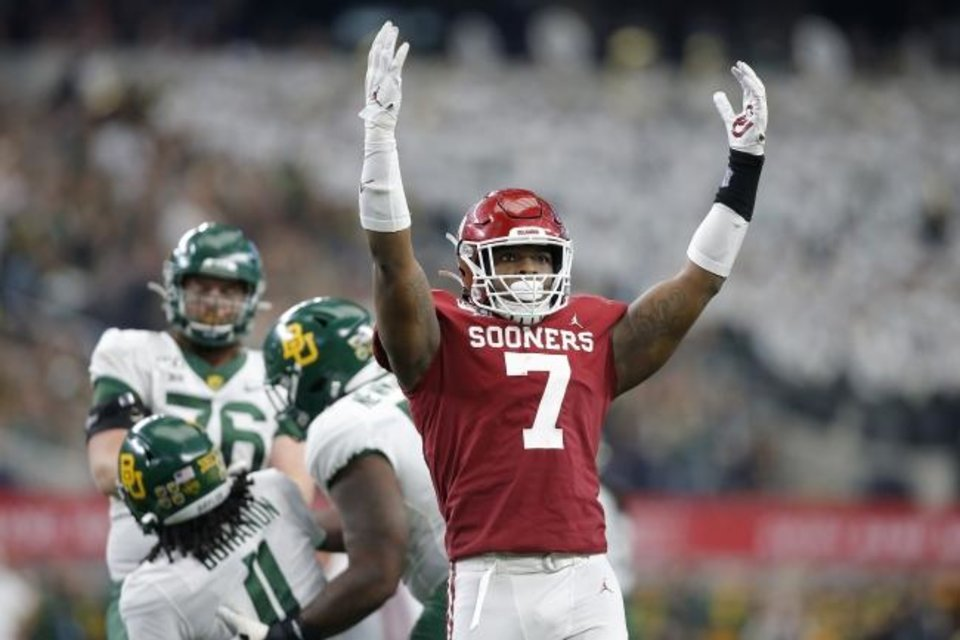 Photo -  Oklahoma's Ronnie Perkins (7) celebrates after a stop against Baylor in a 30-23 overtime win Saturday. [Bryan Terry/The Oklahoman]