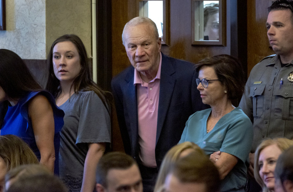 Photo - Former University of Oklahoma football coach Barry Switzer arrives to the courtroom to hear Judge Thad Balkman read a summery of his decision in the opioid trial at the Cleveland County Courthouse in Norman, Okla. on Monday, Aug. 26, 2019. The proceeding were the first public trial to emerge from roughly 2,000 U.S. lawsuits aimed at holding drug companies accountable for the nationÕs opioid crisis.  [Chris Landsberger/Pool]