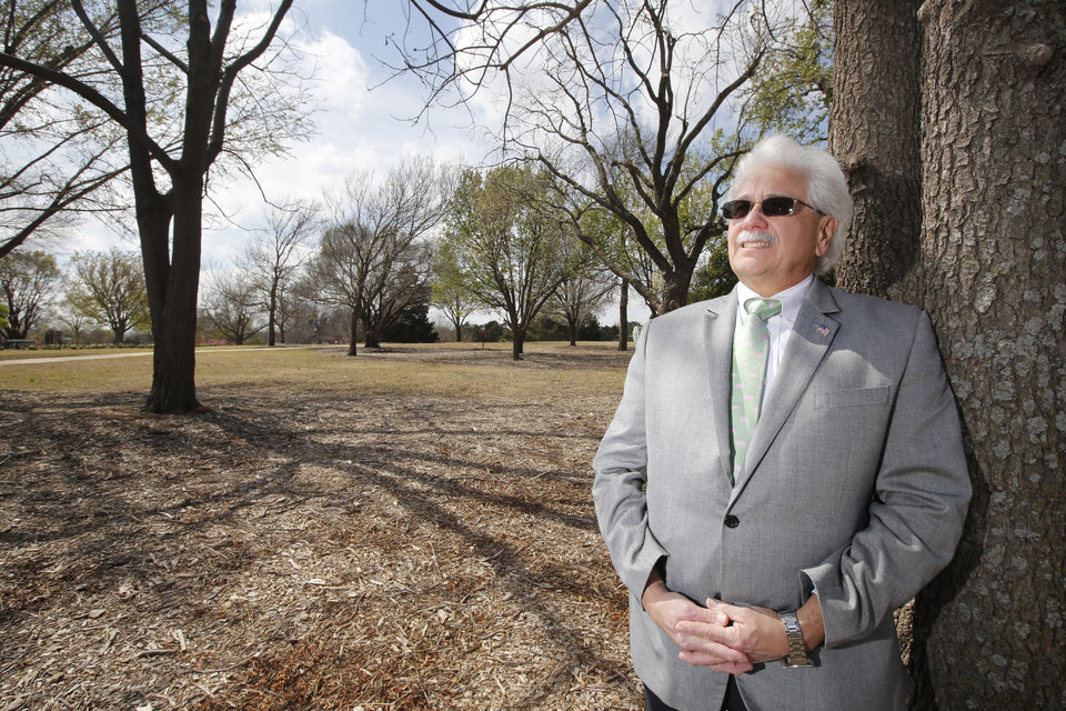 Photo -  Oklahoma City Parks and Recreation Director Douglas Kupper views the trees at Will Rogers Gardens in Oklahoma City. [Photo By Steve Gooch, The Oklahoman]