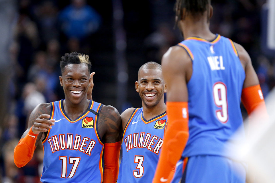 Photo - Oklahoma City's Dennis Schroder (17), Chris Paul (3) and Nerlens Noel (9) celebrate during the NBA basketball game between the Oklahoma City Thunder and the Portland Trail Blazers at the Chesapeake Energy Arena in Oklahoma City, Saturday, Jan. 18, 2020.  [Sarah Phipps/The Oklahoman]