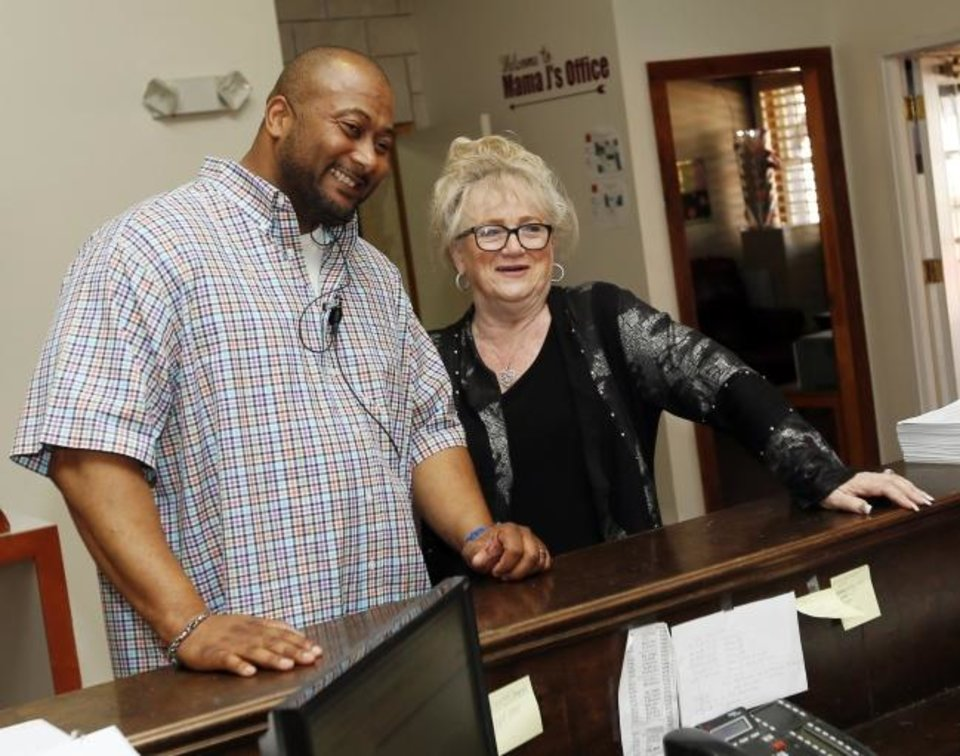 Photo -  Building principal Tarrence Rodgers and Superintendent Janet Grigg talk at the front desk of the Justice Alma Wilson SeeWorth Academy at 12600 N Kelley Ave. in Oklahoma City, in 2016. [Nate Billings/The Oklahoman]