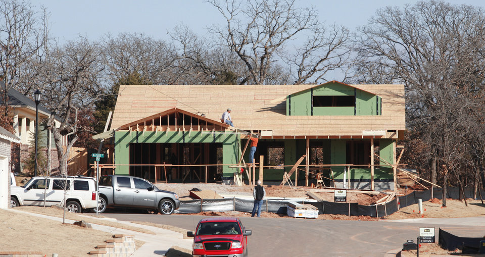 Photo - This is a bungalow being built on Nature Lane. Edmond builder-developer Caleb McCaleb turned to smaller homes last year with Arbor Creek, his addition east of Interstate 35 and north of Second Street. Photo by Steve Gooch THE OKLAHOMAN
