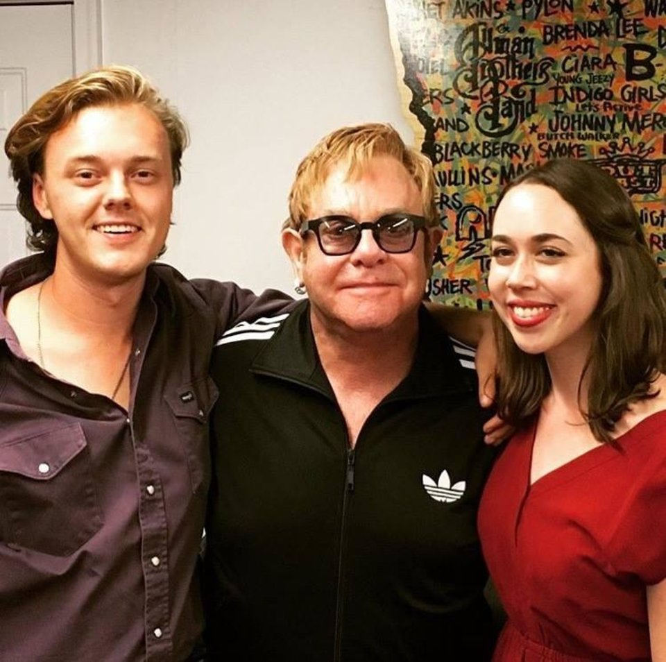 Photo -  From left, Purcell native Parker Millsap, Elton John and Sarah Jarosz backstage at an Atlanta concert. [Photo provided]