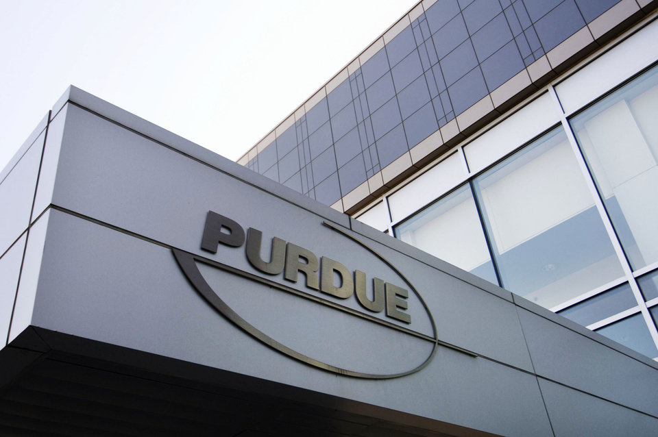 Photo -  FILE - This Tuesday, May 8, 2007 file photo shows the Purdue Pharma logo at their offices in Stamford, Conn. The company that has made billions selling the prescription painkiller OxyContin is among opioid manufacturers being sued by the state of Oklahoma. [AP PHOTO]