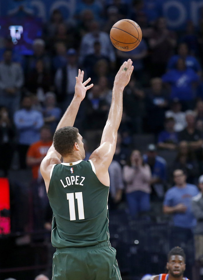 Photo - Milwaukee's Brook Lopez (11) shoots a 3-point basket late in the fourth quarter during the NBA game between the Oklahoma City Thunder and the Milwaukee Bucks at Chesapeake Energy Arena,   Sunday, Nov. 10, 2019.  [Sarah Phipps/The Oklahoman]