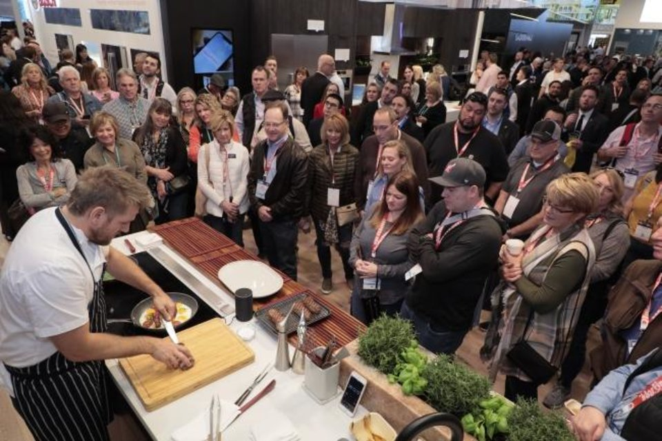 Photo -  A crowd watches a kitchen demonstration at the International Builders Show. [OSCAR EINZIG PHOTOGRAPHY]