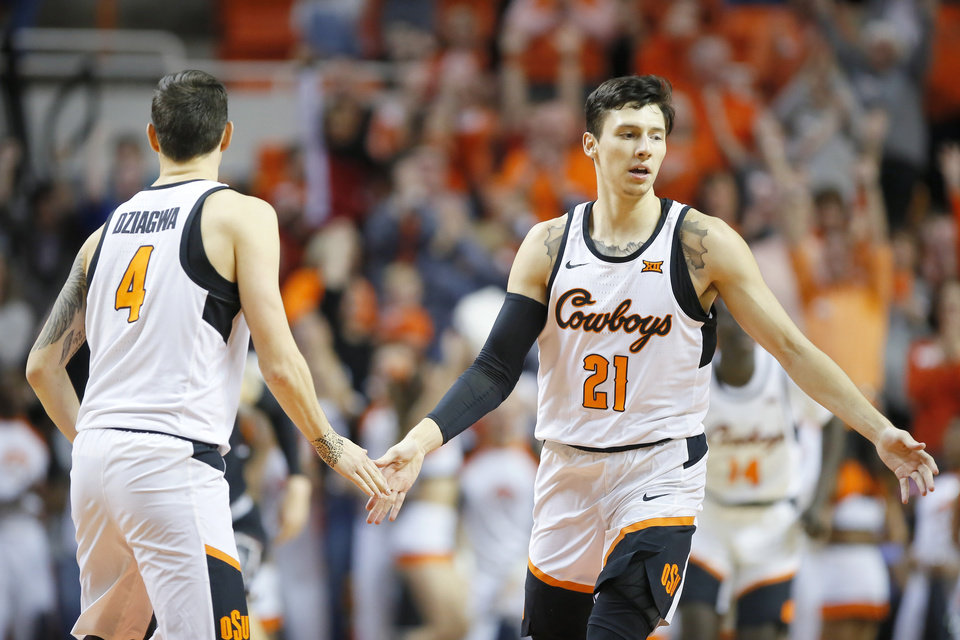 Photo - Oklahoma State's Thomas Dziagwa (4) and Lindy Waters III (21) celebrate after a basket during a NCAA basketball game between the Oklahoma State Cowboys (OSU) and the University of South Carolina at Gallagher-Iba Arena in Stillwater, Okla., Saturday, Jan. 26, 2019. Photo by Bryan Terry, The Oklahoman