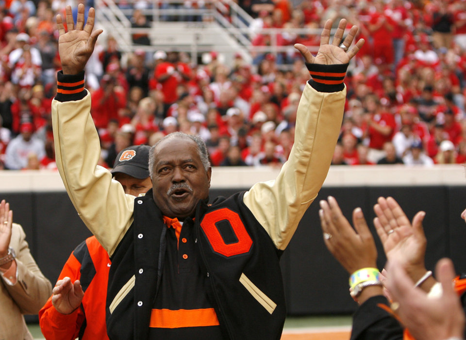 Photo - OSU's Chester Pittman waves to the crowd after being honored during the college football game between the Oklahoma State Cowboys (OSU) and the Nebraska Huskers (NU) at Boone Pickens Stadium in Stillwater, Okla., Saturday, Oct. 23, 2010. Photo by Sarah Phipps, The Oklahoman