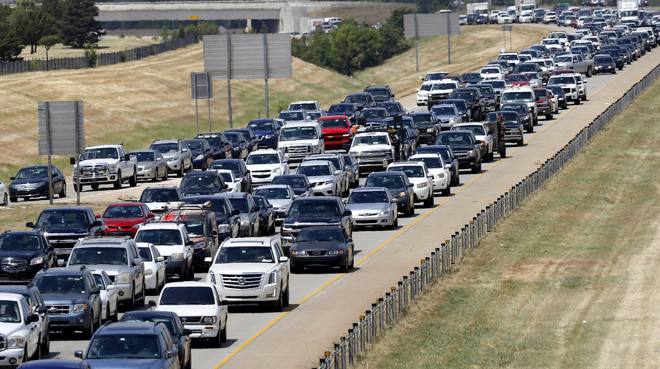 Photo -  A traffic jam in is pictured along Lake Hefner Parkway, where a local advertising company hoped to install an electronic billboard. [Jim Beckel/The Oklahoman archives]