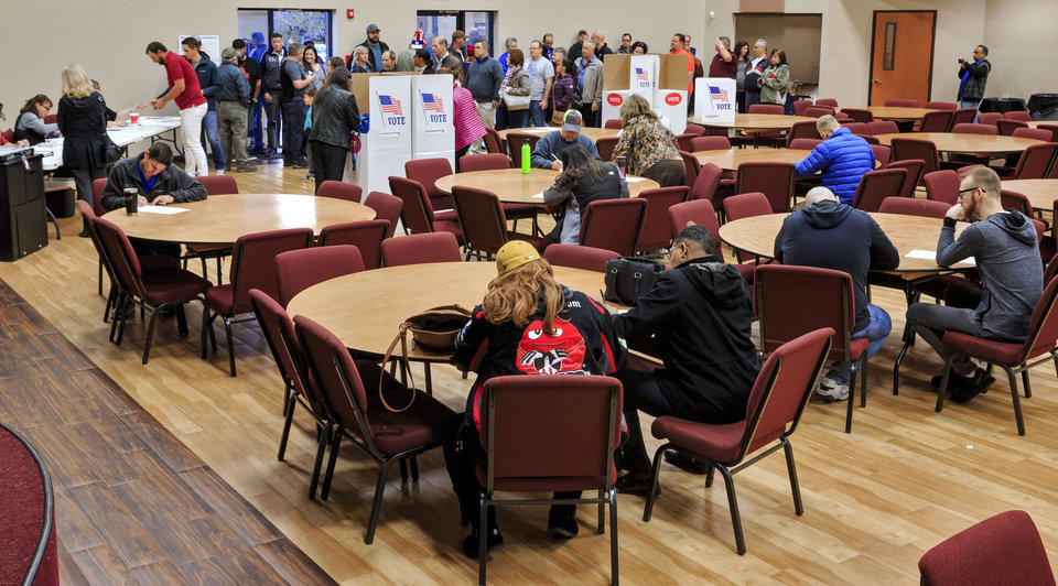 Photo - Voters gather at the International Pentecostal Assembly in Yukon, Okla. on Tuesday, Nov. 6, 2018, to cast their ballots on election day. Photo by Chris Landsberger, The Oklahoman