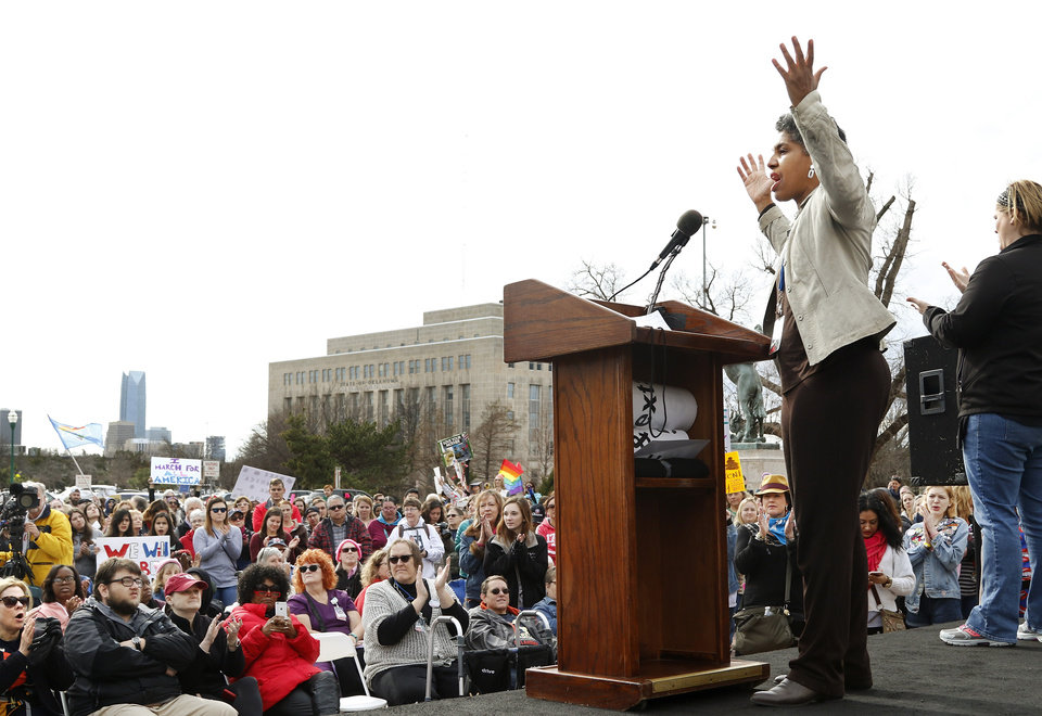 Photo - State Representative Regina Goodwin, District 73, Tulsa) delivers an animated and spirited oratory. A crowd estimated by organizers to be as many as 7,000 people came to the state Capitol in Oklahoma City Saturday, Jan. 21, 2017, to rally, using their voices and signs to express displeasure with the nation's new administration as part of a larger network of marches taking place across the country following Donald Trump's inauguration.   The Women's March on Oklahoma included a walk along Lincoln Blvd., with the Capitol as a backdrop, and a rally on the Capitol's south plaza that featured nearly a dozen speakers.  Photo by Jim Beckel, The Oklahoman