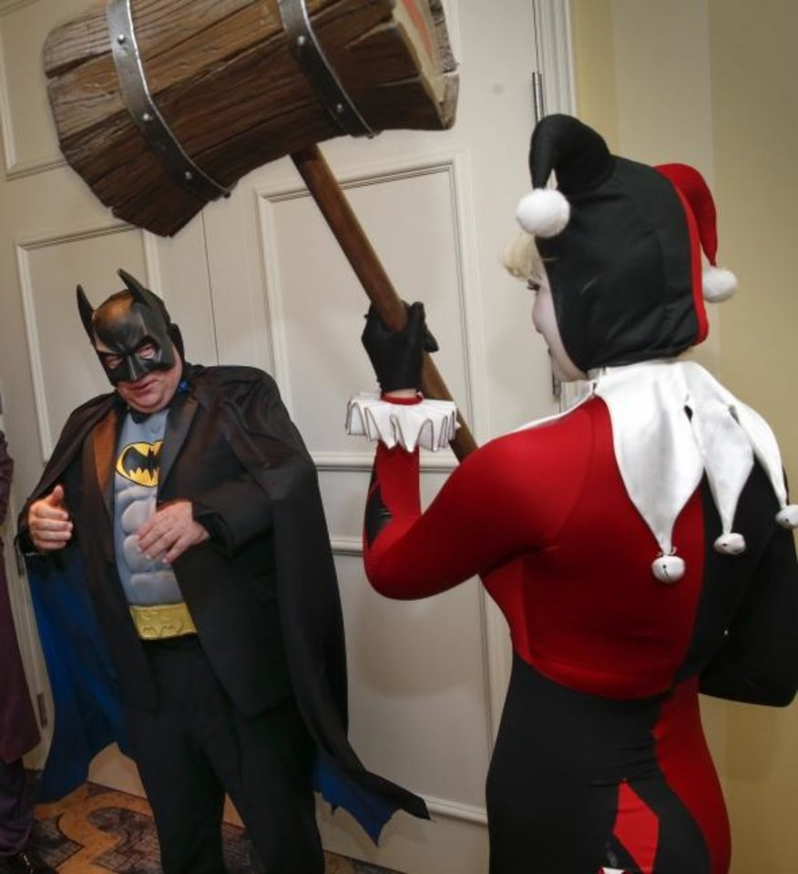 Photo -  Joe Dorman, CEO of the Oklahoma Institute for Child Advocacy, as Batman, jokes around with Abigail Woodson, as Harley Quinn, during the OICA's Heroes Ball at the Skirvin Hilton hotel. [Nate Billings/The Oklahoman]