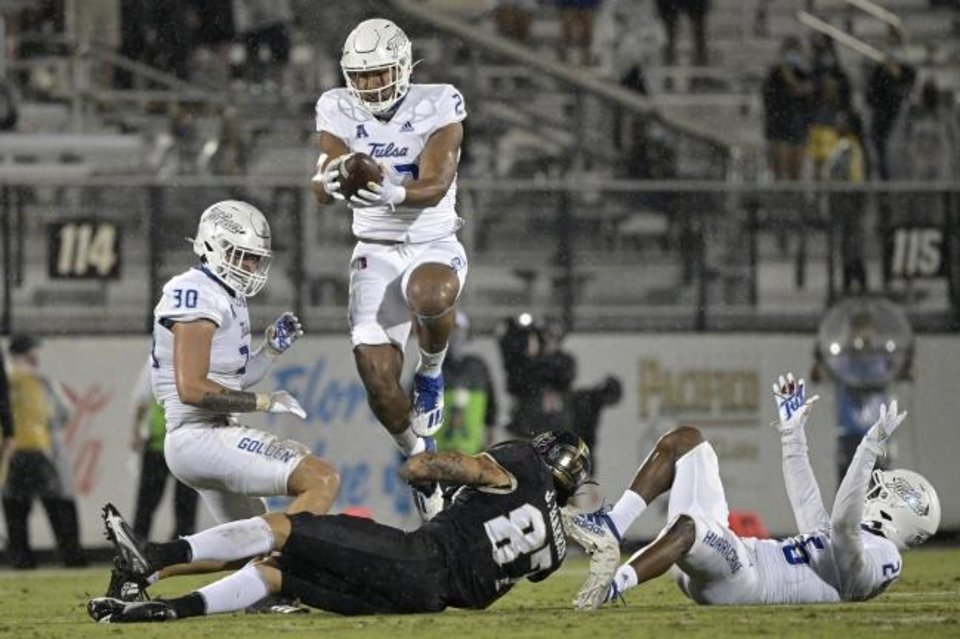 Photo -  Tulsa linebacker Zaven Collins (23) intercepts a pass intended for Central Florida wide receiver Jacob Harris (87) after the ball in a 34-25 win on Oct. 3 in Orlando, Fla. [AP Photo/Phelan M. Ebenhack]