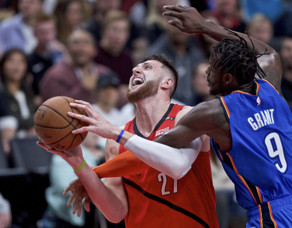 Photo - Portland Trail Blazers center Jusuf Nurkic, left, is fouled by Oklahoma City Thunder forward Jerami Grant during the second half of an NBA basketball game in Portland, Ore., Friday, Jan. 4, 2019. (AP Photo/Craig Mitchelldyer)