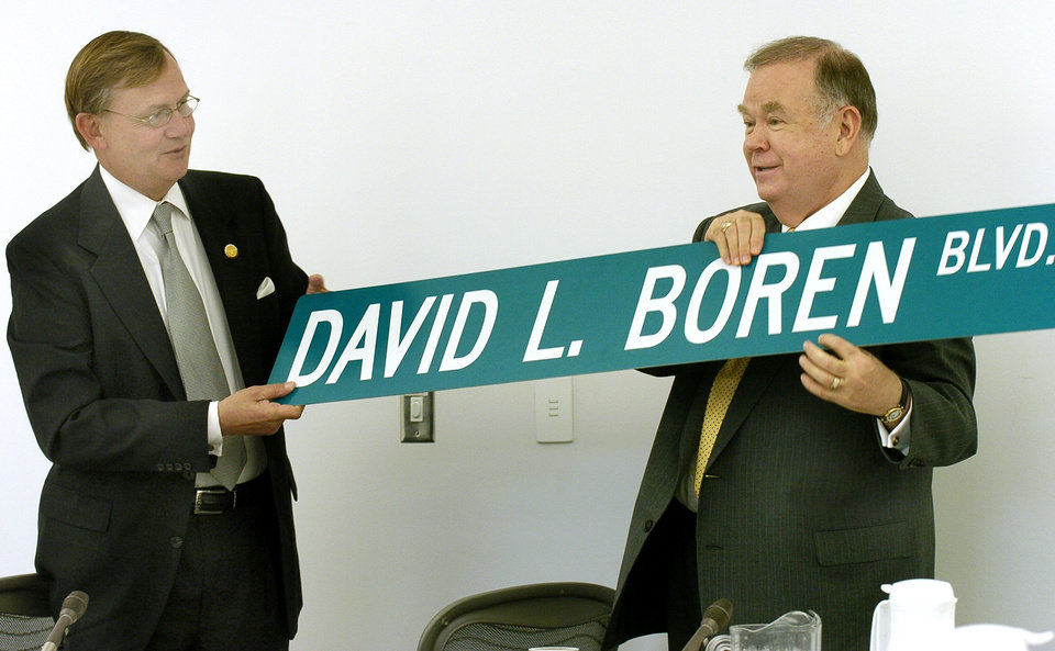 Photo - Norman, Ok, Friday, May 7, 2004.       STREET NAME CHANGE: University of Oklahoma (OU) President David Boren is given a street sign with his name on it. His name will replace Constellation Drive extending east and west between the Weather Center on the south and the Stephenson Research Building on the North. Chairmen Stephen Bentley hands Boren the street sign. Oklahoman staff photo by Ty Russell.
