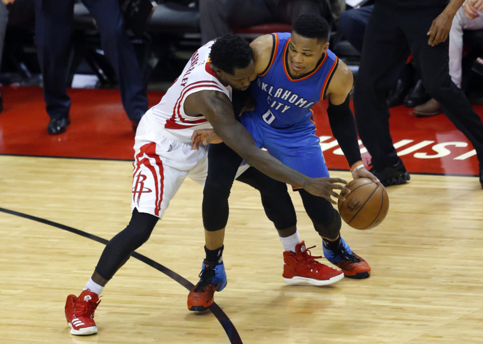 Photo - Houston's Patrick Beverley (2) defends against Oklahoma City's Russell Westbrook (0) during Game 2 in the first round of the NBA playoffs between the Oklahoma City Thunder and the Houston Rockets in Houston, Texas,  Wednesday, April 19, 2017.  Photo by Sarah Phipps, The Oklahoman