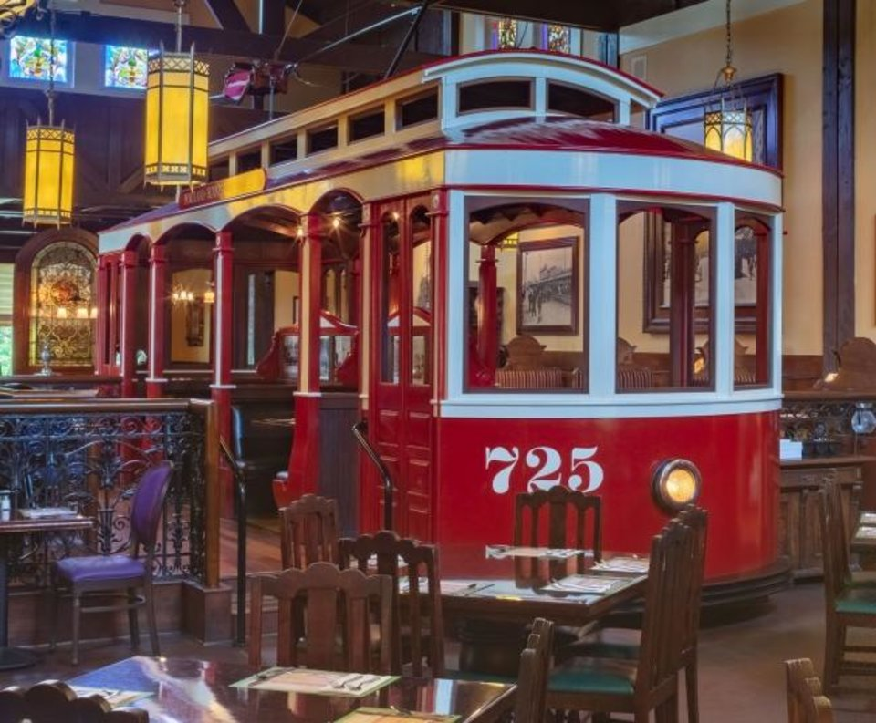 Photo -  Old fashioned trolley cars, stained glass, antiques and Tiffany lamps are fixtures in Old Spaghetti Factory restaurants throughout the country. [PROVIDED]