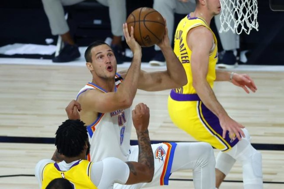 Photo -  Thunder forward Danilo Gallinari drives to the basket against the Lakers during the second quarter Wednesday in Lake Buena Vista, Fla. [Kevin C. Cox/Pool Photo via AP]