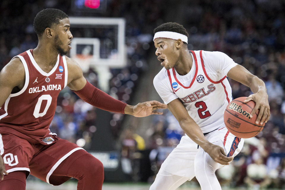 Photo - Mississippi guard Devontae Shuler (2) dribbles the ball against Oklahoma guard Christian James (0) during a first-round game in the NCAA men's college basketball tournament Friday, March 22, 2019, in Columbia, S.C. Oklahoma defeated Mississippi 95-72. (AP Photo/Sean Rayford)