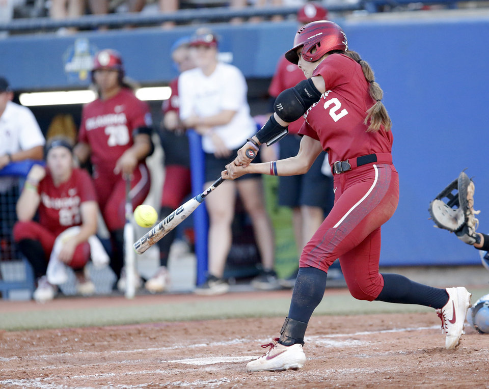Photo - Oklahoma's Sydney Romero (2) hits a home run in the 3rd inning during the second NCAA softball game in the championship series of the Women's College World Series between Oklahoma and UCLA at USA Softball Hall of Fame Stadium in Oklahoma City, Tuesday, June 4, 2019. [Sarah Phipps/The Oklahoman]
