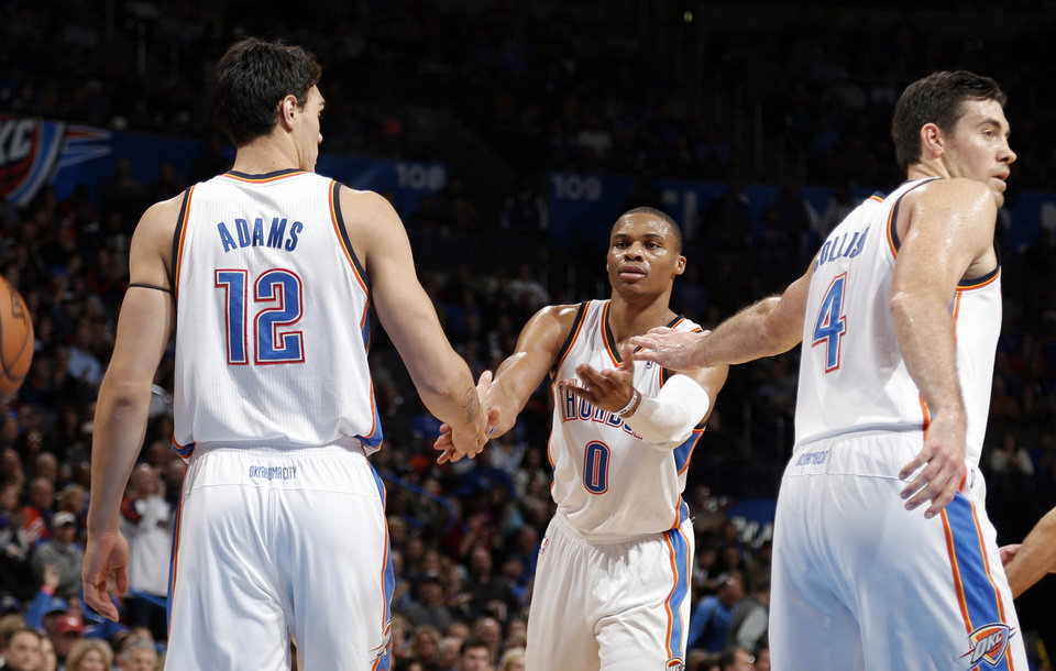 Photo - Oklahoma City's Steven Adams (12), Russell Westbrook (0) and Nick Collison (4) celebrate a play during the NBA game between the Oklahoma City Thunder and the Indiana Pacers at the Chesapeake Energy Arena, Sunday, Dec. 8, 2013. Photo by Sarah Phipps, The Oklahoman