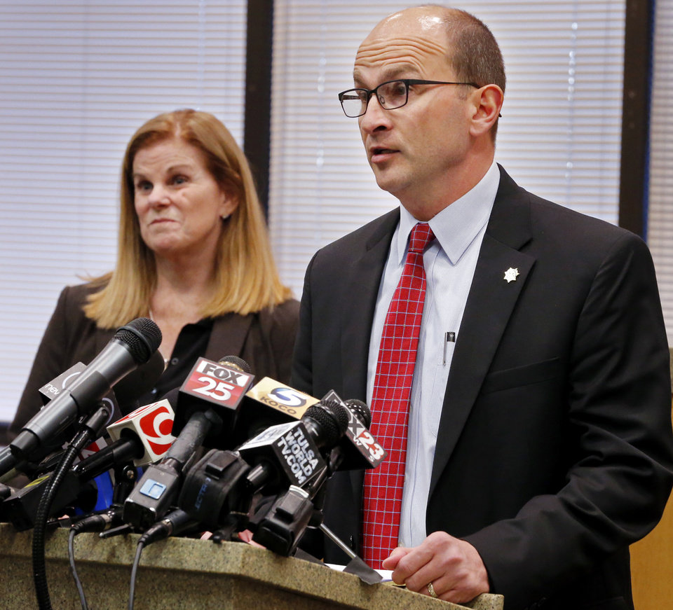 Photo -  Cleveland County District Attorney Greg Mashburn and his first assistant, Susan Caswell, announce at a news conference Thursday that no charges will be brought against University Of Oklahoma running back Rodney Anderson.  [Photo by Steve Sisney, The Oklahoman]