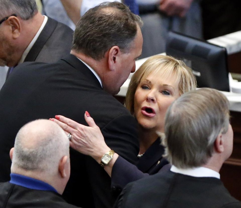 Photo - State Senator Joh Sparks hugs Oklahoma Governor Mary Fallin following her final State of the State Address in the chambers of the Oklahoma House of Representatives on Monday, Feb. 5, 2018 in Oklahoma City, Okla.  Photo by Steve Sisney, The Oklahoman
