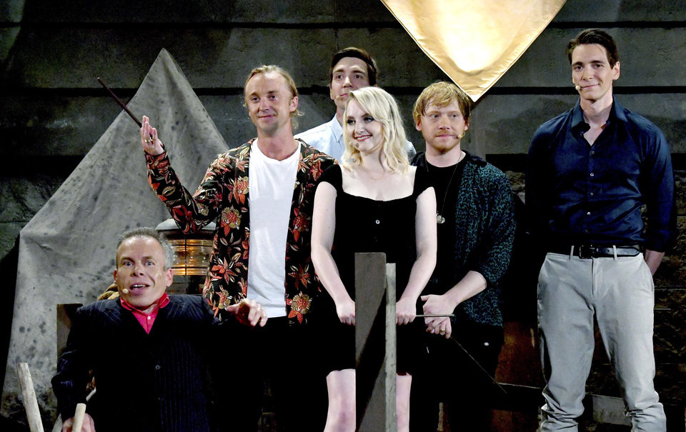 Photo -  In this June 11, 2019 photo, Harry Potter cast members from left to right, Warwick Davis, Tom Felton, Evanna Lynch, Rupert Grint, and James and Oliver Phelps attend the opening ceremony of Hagrid's Magical Creatures Motorbike Adventure at Universal Orlando Resort, in Orlando, Fla. The new rollercoaster is located at the Wizarding World of Harry Potter. [Tim Shortt/Florida Today via AP]