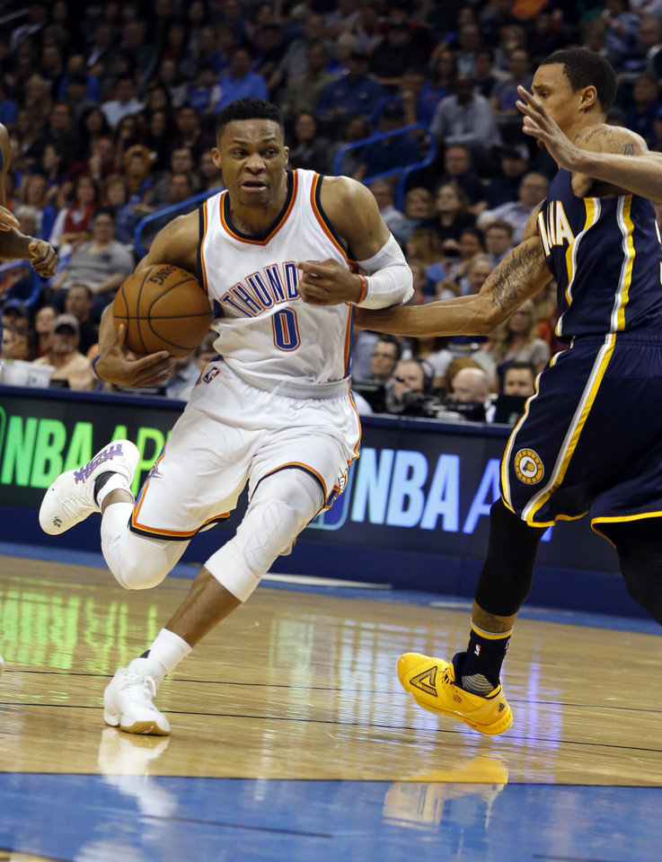 Photo - Oklahoma City Thunder's Russell Westbrook (0) drives past Indiana's George Hill (3) in the second half of an NBA basketball game where the Oklahoma City Thunder lost to the Indiana Pacers 101-98 at the Chesapeake Energy Arena in Oklahoma City, on Feb. 19, 2016.  Photo by Steve Sisney The Oklahoman