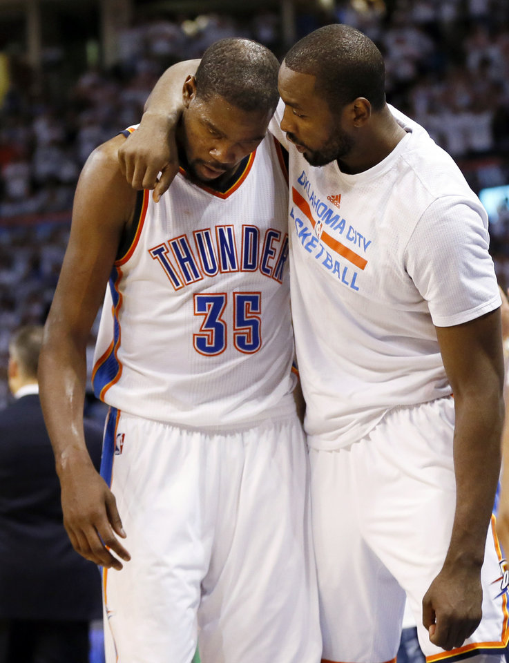 Photo - Oklahoma City's Serge Ibaka (9), right, puts his arm around Kevin Durant (35) as Durant leaves the court in the final minute of the fourth quarter during Game 4 of the Western Conference semifinals between the Oklahoma City Thunder and the San Antonio Spurs in the NBA playoffs at Chesapeake Energy Arena in Oklahoma City, Sunday, May 8, 2016. Oklahoma City won 111-97. Photo by Nate Billings, The Oklahoman