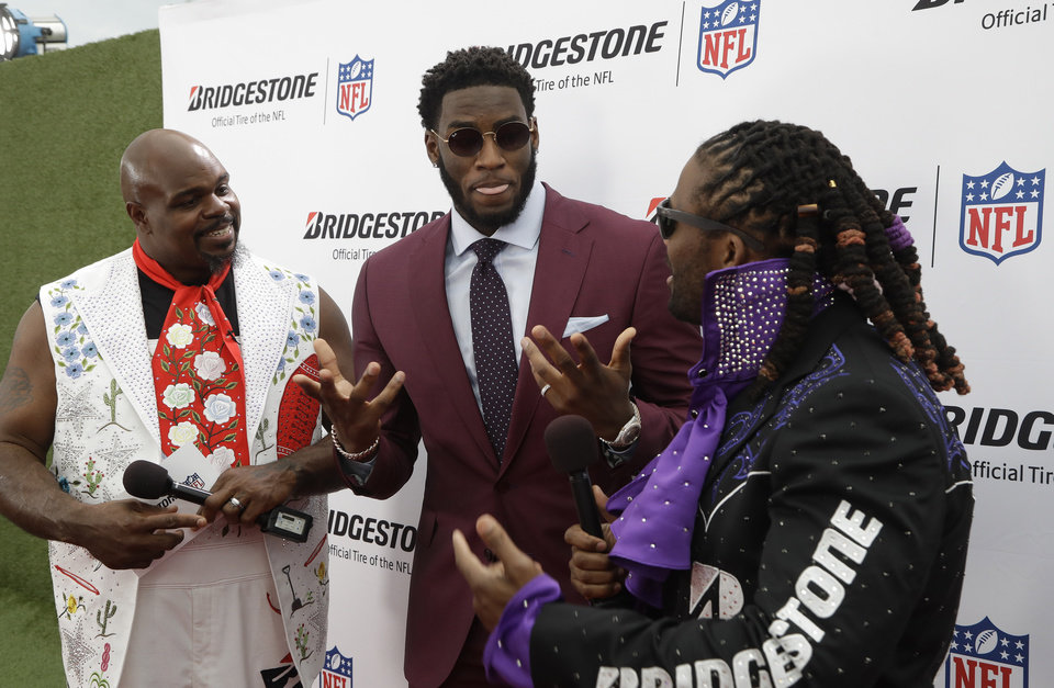 Photo - Vince Wilfork, left and DeAngelo Williams, right, speaks with Florida State defensive end Brian Burns on the red carpet ahead of the first round at the NFL football draft, Thursday, April 25, 2019, in Nashville, Tenn. (AP Photo/Steve Helber)