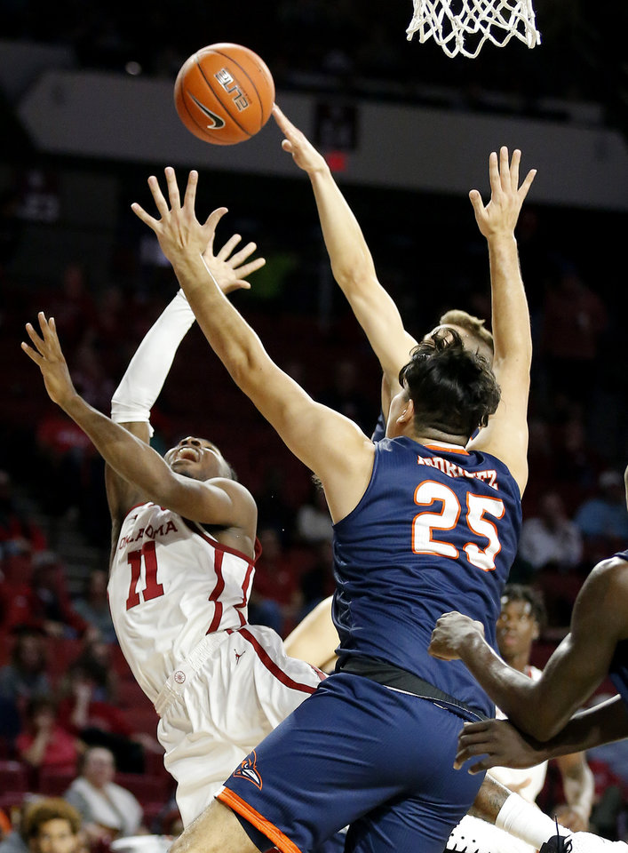 Photo - Oklahoma's De'Vion Harmon (11) shoots a a lay up as UTSA's Adrian Rodriguez (25) defends during the college basketball game between the University of Oklahoma and the UTSA Roadrunners at the Lloyd Noble Center in Norman, Okla.,  Tuesday, Nov. 5, 2019.  [Sarah Phipps/The Oklahoman]