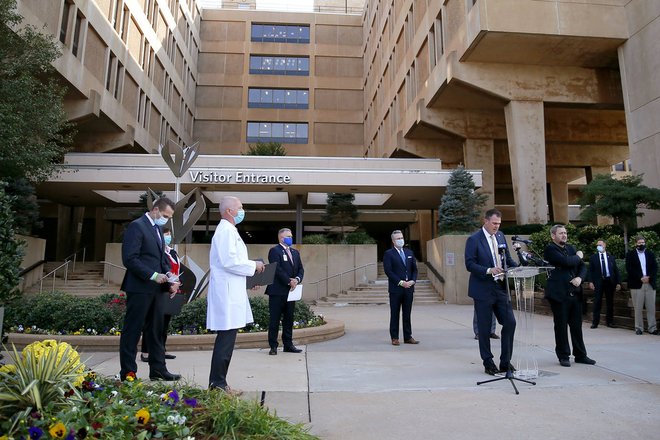 Photo - Gov. Kevin Stitt talks about the revised hospital surge plan during a press conference outside Mercy Hospital in Oklahoma City, Tuesday, Oct. 20, 2020. [Bryan Terry/The Oklahoman]