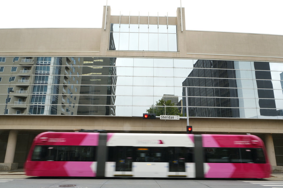 Photo - An OKC Streetcar drives by the front of the Cox Convention Center. Prairie Surf Media, owned by Rachel Cannon and Matt Payne discussing the conversion of the Cox Center into a space to be used for sound stages and production, Friday, September 11, 2020. [Doug Hoke/The Oklahoman]