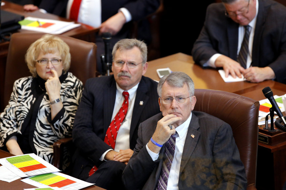 Photo - Rep. Marian Cooksey, Sen. Jack Fry and House Majority Whip Gary Banz, from left, listen in during the Oklahoma Legislature's 2016 State-of-the-State Address by Gov. Mary Fallin in the chamber of the House of Representatives at the Oklahoma state capitol on Monday, Feb. 1, 2016, in Oklahoma City, Okla. Photo by Jim Beckel, The Oklahoman