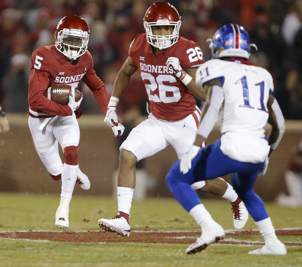 Photo - Oklahoma's Marquise Brown (5) runs after a reception during a college football game between the University of Oklahoma Sooners (OU) and the Kansas Jayhawks (KU) at Gaylord Family-Oklahoma Memorial Stadium in Norman, Okla., Saturday, Nov. 17, 2018. Photo by Bryan Terry, The Oklahoman