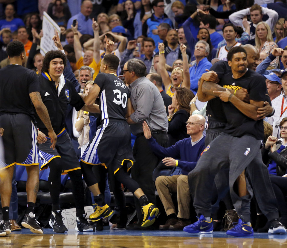 Photo - Stephen Curry (30) and the Golden State Warriors celebrate after Curry made the game-winning shot with less than a second left in overtime during an NBA basketball game between the Oklahoma City Thunder and the Golden State Warriors at Chesapeake Energy Arena in Oklahoma City, Saturday, Feb. 27, 2016. Golden State won 121-118 in overtime. Photo by Nate Billings, The Oklahoman