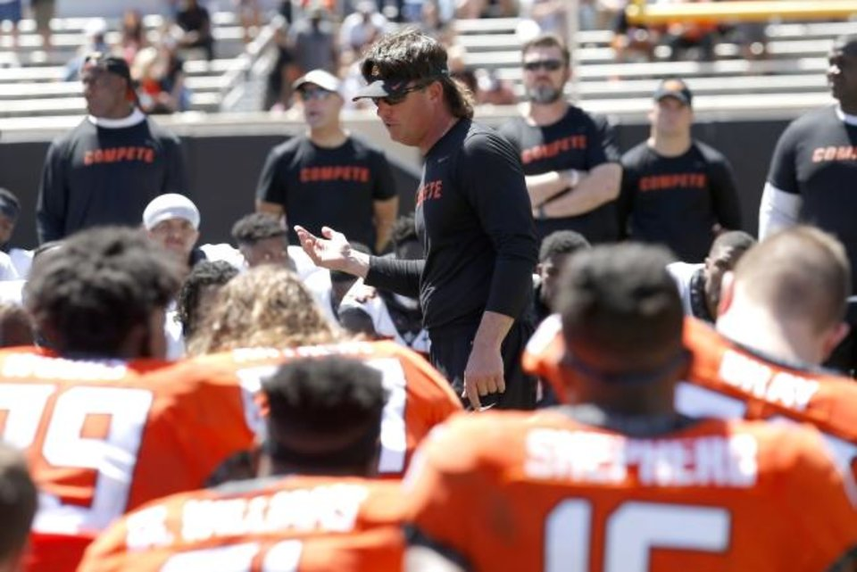 Photo -  Mike Gundy talks with his team following OSU's April 20 spring practice. [Sarah Phipps/The Oklahoman]