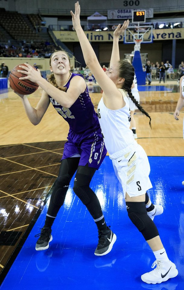 Photo - Okarche's Sarah Griswold (32) goes to the basket against Seiling's Rylee Ortega (32) during the Class A girls state semi finals basketball game between Okarche and Seiling at the State Fair Arena in Oklahoma City, Okla. on Friday, March 2, 2018. [Photo by Chris Landsberger/The Oklahoman]