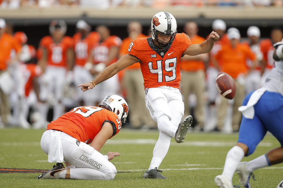 Photo - Oklahoma State's Matt Ammendola (49) kicks a long field goal during a college football game between the Oklahoma State University Cowboys (OSU) and the Boise State Broncos at Boone Pickens Stadium in Stillwater, Okla., Saturday, Sept. 15, 2018. Oklahoma State won 44-21. Photo by Bryan Terry, The Oklahoman
