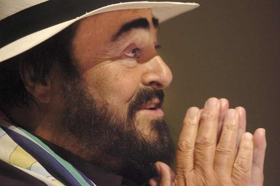 Photo - Tenor Luciano Pavarotti speaks at a 2005 press conference in Tulsa about his concert stop in Tulsa. The Oklahoman Archives